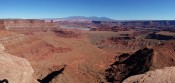 View from Dead Horse Point to the east across Permian to Jurassic units, with the Cane Creek anticline and the La Sal Mountains in the background.