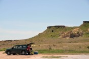 Writing notes at Castle Rock, a crumbling outcrop of Niobrara Chalk southwest of Hays, KS.