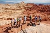 Discussing paleo-fluid flow and diagenetic alteration at Valley of Fire, Nevada. The alteration contact reflects paleo-fluid flow associated with Cretaceous thrust tectonics.Photo: A. Fall.