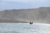 Boating the Colville River in a sandstorm.